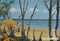 "<span class=""caption-caption"">Coochie Mudlo Island</span>, c1980. <br />Postcard folder by <span class=""caption-publisher"">Sydney G Hughes Pty Ltd</span>, collection of <span class=""caption-contributor"">Centre for the Government of Queensland</span>."