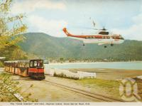 "<span class=""caption-caption"">The 'Coral Islander' and train, Hayman Island, Great Barrier Reef</span>, 1975. <br />Postcard folder by <span class=""caption-publisher"">Murray Views Pty Ltd</span>, collection of <span class=""caption-contributor"">Centre for the Government of Queensland MS</span>."