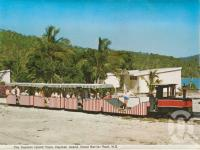 "<span class=""caption-caption"">The Hayman Island train, Hayman Island, Great Barrier Reef</span>, 1975. <br />Postcard folder by <span class=""caption-publisher"">Murray Views Pty Ltd</span>, collection of <span class=""caption-contributor"">Centre for the Government of Queensland MS</span>."
