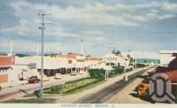 "<span class=""caption-caption"">Herbert Street, Bowen</span>, c1955. <br />Postcard folder by <span class=""caption-publisher"">Sydney G Hughes Pty Ltd</span>, collection of <span class=""caption-contributor"">Centre for the Government of Queensland MS</span>."