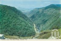 """<span class=""""caption-caption"""">Redlynch Valley from Barron Gorge, Kuranda</span>, c1960. <br />Postcard folder by <span class=""""caption-publisher"""">Murray Views Pty Ltd</span>, collection of <span class=""""caption-contributor"""">Centre for the Government of Queensland MS</span>."""