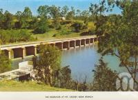 "<span class=""caption-caption"">The reservoir at Mt Crosby, near Ipswich</span>, c1974. <br />Postcard folder by <span class=""caption-publisher"">Sydney G Hughes Pty Ltd</span>, collection of <span class=""caption-contributor"">Centre for the Government of Queensland MS</span>."