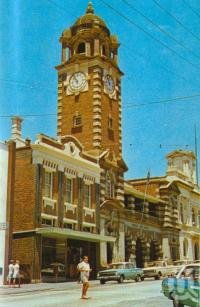 "<span class=""caption-caption"">Post Office, Ipswich</span>, c1974. <br />Postcard folder by <span class=""caption-publisher"">Sydney G Hughes Pty Ltd</span>, collection of <span class=""caption-contributor"">Centre for the Government of Queensland MS</span>."