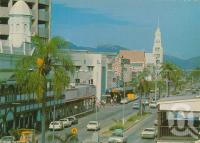 """<span class=""""caption-caption"""">Flinders Street, Townsville</span>, c1970. <br />Postcard by <span class=""""caption-publisher"""">Nu-Color-Vue</span>, collection of <span class=""""caption-contributor"""">Centre for the Government of Queensland</span>."""
