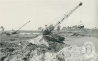"<span class=""caption-caption"">Excavating canals at Miami Keys Estate development</span>. <br />From <span class=""caption-book"">Gold Coast: The story of the Gold Coast of Queensland and Hinterland</span>, 1958, collection of <span class=""caption-contributor"">John Young</span>."