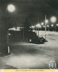 "<span class=""caption-caption"">Night view of the Kangaroo Point entrance to Story Bridge</span>, 1949. <br />Booklet, collection of <span class=""caption-contributor"">John Young</span>."