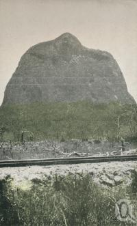 "<span class=""caption-caption"">Glass House Mountains</span>. <br />From <span class=""caption-book"">Glimpses of Sunny Queensland (2nd edition)</span>, <span class=""caption-creator"">Queensland Government Intelligence and Tourist Bureau</span>, Brisbane, 1912, collection of <span class=""caption-contributor"">Centre for the Government of Queensland</span>."