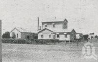 """<span class=""""caption-caption"""">Co-operative Butter Factory Roma</span>. <br />From <span class=""""caption-book"""">The Pocket Queensland</span>, <span class=""""caption-creator"""">Queensland Government Intelligence and Tourist Bureau</span>, Brisbane, 1921, collection of <span class=""""caption-contributor"""">Centre for the Government of Queensland</span>."""