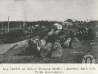 "<span class=""caption-caption"">Log timber at Kulara Railway Station, Atherton Tableland</span>. <br />From <span class=""caption-book"">The Pocket Queensland</span>, <span class=""caption-creator"">Queensland Government Intelligence and Tourist Bureau</span>, Brisbane, 1921, collection of <span class=""caption-contributor"">Centre for the Government of Queensland</span>."
