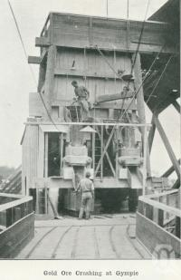 """<span class=""""caption-caption"""">Gold ore crushing at Gympie</span>. <br />From <span class=""""caption-book"""">Australia Unlimited</span>, <span class=""""caption-creator"""">Edwin J Brady</span>, <span class=""""caption-publisher"""">George Robertson & Co</span>, Melbourne, 1918, collection of <span class=""""caption-contributor"""">Centre for the Government of Queensland</span>."""