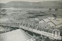 "<span class=""caption-caption"">A view across the holding yards of the Alligator Creek Meat Works, outside the North Queensland city of Townsville</span>. <br />From <span class=""caption-book"">This is Australia</span>, <span class=""caption-creator"">Oswald L. Ziegler Pty Ltd</span>, Sydney, 1956, collection of <span class=""caption-contributor"">Centre for the Government of Queensland</span>."