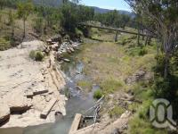 """<span class=""""caption-caption"""">Medway Creek site of Bogantungan rail accident of 1960 that killed 7 people</span>, 2009. <br />Digital image, collection of <span class=""""caption-contributor"""">Centre for the Government of Queensland MS</span>."""