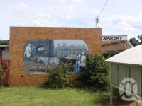 """<span class=""""caption-caption"""">Alpha bakery mural</span>, 2009. <br />Digital image, collection of <span class=""""caption-contributor"""">Centre for the Government of Queensland MS</span>."""