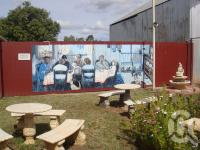 "<span class=""caption-caption"">Alpha mural</span>, 2009. <br />Digital image, collection of <span class=""caption-contributor"">Centre for the Government of Queensland MS</span>."