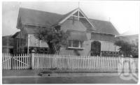"<span class=""caption-caption"">St Elmo Guest House, Second Avenue, Sandgate</span>, c1930s-c1940s. <br />Photographic collection, <span class=""caption-contributor"">Queensland State Archives</span>."