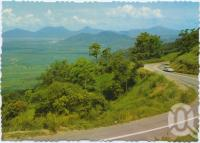 """<span class=""""caption-caption"""">Overlooking cane fields, Redlynch, from Cairns-Kuranda Highway</span>, c1970-2000. <br />Postcard, collection of <span class=""""caption-contributor"""">Murray Views Collection</span>."""