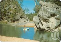 "<span class=""caption-caption"">""The Swimming Pool"", nestled in these peaceful surroundings of the Carnarvon Ranges, Central Highlands</span>, c1970-2000. <br />Postcard, collection of <span class=""caption-contributor"">Murray Views Collection</span>."