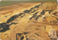 "<span class=""caption-caption"">Aerial view featuring an open cut coal mine, Moranbah</span>, c1970-2000. <br />Postcard, collection of <span class=""caption-contributor"">Murray Views Collection</span>."