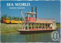 """<span class=""""caption-caption"""">The """"Sea World Belle"""" Paddleboat and Ol '99, Sea World's colourful train - two of the great rides at Sea World, Surfers Paradise</span>, c1970-2000. <br />Postcard, collection of <span class=""""caption-contributor"""">Murray Views Collection</span>."""