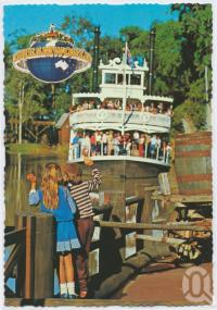 "<span class=""caption-caption"">Modern young children provoke memories of Mark Twain's ""Huckleberry Finn"" as the Captain Sturt rounds a bend in the river, Dreamworld, Coomera</span>, c1970-2000. <br />Postcard, collection of <span class=""caption-contributor"">Murray Views Collection</span>."