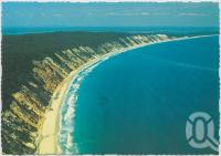 "<span class=""caption-caption"">Aerial view looking towards Rainbow Beach</span>, c1970-2000. <br />Postcard, collection of <span class=""caption-contributor"">Murray Views Collection</span>."