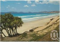 "<span class=""caption-caption"">Surfing beach looking towards Double Island Point, Rainbow Beach</span>, c1970-2000. <br />Postcard, collection of <span class=""caption-contributor"">Murray Views Collection</span>."
