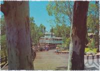 "<span class=""caption-caption"">The Captain Sturt Paddle Wheeler arrives in Rivertown, Dreamworld, Coomera</span>, c1970-2000. <br />Postcard, collection of <span class=""caption-contributor"">Murray Views Collection</span>."
