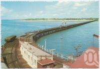 "<span class=""caption-caption"">Wharf and pier at Urangan</span>, c1970-2000. <br />Postcard, collection of <span class=""caption-contributor"">Murray Views Collection</span>."