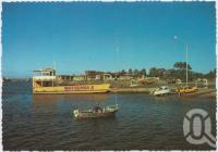 "<span class=""caption-caption"">The Urangan Boat Harbour showing the Fraser Island Barge</span>, c1970-2000. <br />Postcard, collection of <span class=""caption-contributor"">Murray Views Collection</span>."