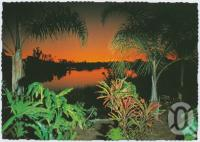 "<span class=""caption-caption"">Sunset and gardens overlooking lake, Melanesia Village, Urangan, Hervey Bay</span>, c1970-2000. <br />Postcard, collection of <span class=""caption-contributor"">Murray Views Collection</span>."