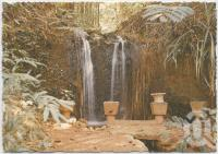 """<span class=""""caption-caption"""">Theresa Creek Falls from one of the many secluded corners of Paronella Park</span>, c1970-2000. <br />Postcard, collection of <span class=""""caption-contributor"""">Murray Views Collection</span>."""