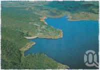 "<span class=""caption-caption"">Aerial view of the dam and lake, Lake Moogerah</span>, c1970-2000. <br />Postcard, collection of <span class=""caption-contributor"">Murray Views Collection</span>."