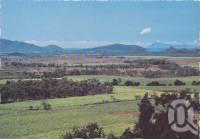 "<span class=""caption-caption"">From Mt Jukes Lookout across a valley 9of canefields to the sea.  Brampton Island is in the background, Seaforth</span>, c1970-2000. <br />Postcard, collection of <span class=""caption-contributor"">Murray Views Collection</span>."