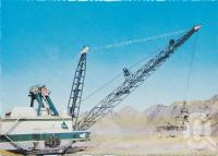 """<span class=""""caption-caption"""">Goonyella Dragline, the giant 2,270,000 kilograms (2276.6 tonnes) dragline with a capacity of 48.96 cubic metres, removing the overburden from the Open Cut Coal Mine, Moranbah</span>, c1970-2000. <br />Postcard, collection of <span class=""""caption-contributor"""">Murray Views Collection</span>."""