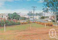 "<span class=""caption-caption"">Flower garden and main street, Mt Garnet</span>, c1970-2000. <br />Postcard, collection of <span class=""caption-contributor"">Murray Views Collection</span>."