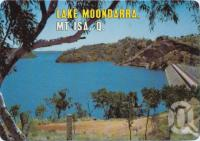 "<span class=""caption-caption"">Lake Moondarra dam wall from the lookout, the lake provides the city of Mt Isa with an abundant water supply and an all year aquatic sports playground</span>, c1970-2000. <br />Postcard, collection of <span class=""caption-contributor"">Murray Views Collection</span>."