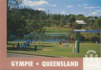 """<span class=""""caption-caption"""">Historical and Goldmining Museum with Lake Alford and Rotoract Park in the foreground, Gympie</span>, c1990. <br />Postcard by <span class=""""caption-publisher"""">Murray Views Pty Ltd</span>, collection of <span class=""""caption-contributor"""">Centre for the Government of Queensland</span>."""