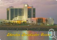 """<span class=""""caption-caption"""">Sheraton Breakwater casino at night, Townsville</span>, 1987. <br />Postcard by <span class=""""caption-publisher"""">Murray Views Pty Ltd</span>, collection of <span class=""""caption-contributor"""">Centre for the Government of Queensland</span>."""