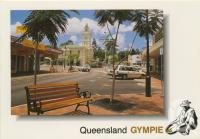 """<span class=""""caption-caption"""">Mary Street looking south towards the Town Hall, Gympie, photograph by Rod Murray</span>, c1990. <br />Postcard by <span class=""""caption-publisher"""">Murray Views Pty Ltd</span>, collection of <span class=""""caption-contributor"""">Centre for the Government of Queensland</span>."""