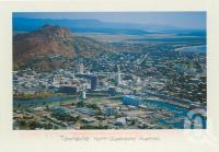 """<span class=""""caption-caption"""">Aerial view overlooking city centre, Townsville, photograph by Rod Murray</span>, 2000. <br />Postcard by <span class=""""caption-publisher"""">Murray Views Pty Ltd</span>, collection of <span class=""""caption-contributor"""">Centre for the Government of Queensland</span>."""