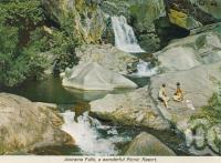 """<span class=""""caption-caption"""">Jourama Falls</span>, c1966. <br />Postcard folder by <span class=""""caption-publisher"""">GK Bolton</span>, collection of <span class=""""caption-contributor"""">Centre for the Government of Queensland MS</span>."""