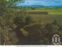 "<span class=""caption-caption"">Looking towards Gatton, featuring rich farmlands of the Lockyer Valley</span>, c1980. <br />Postcard folder by <span class=""caption-publisher"">Murray Views Pty Ltd</span>, collection of <span class=""caption-contributor"">Centre for the Government of Queensland</span>."