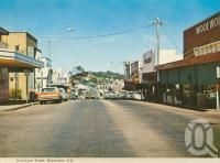 "<span class=""caption-caption"">Goondoon Street, Gladstone</span>, c1975. <br />Postcard folder by <span class=""caption-publisher"">Murray Views Pty Ltd</span>, collection of <span class=""caption-contributor"">Centre for the Government of Queensland</span>."