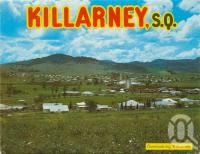 "<span class=""caption-caption"">Overlooking Killarney</span>, 1984. <br />Postcard folder by <span class=""caption-publisher"">Murray Views Pty Ltd</span>, collection of <span class=""caption-contributor"">Centre for the Government of Queensland</span>."