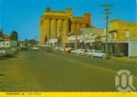 "<span class=""caption-caption"">Haly Street, Kingaroy</span>, c1983. <br />Postcard by <span class=""caption-publisher"">Samuel Lee & Co Pty Ltd</span>, collection of <span class=""caption-contributor"">Centre for the Government of Queensland</span>."