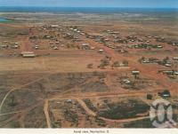 "<span class=""caption-caption"">Aerial view, Normanton</span>, c1983. <br />Postcard folder by <span class=""caption-publisher"">Murray Views Pty Ltd</span>, collection of <span class=""caption-contributor"">Centre for the Government of Queensland</span>."