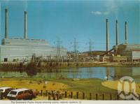 "<span class=""caption-caption"">The Swanbank Power Station showing the picnic reserve, Ipswich</span>, c1976. <br />Postcard folder by <span class=""caption-publisher"">Murray Views Pty Ltd</span>, collection of <span class=""caption-contributor"">Centre for the Government of Queensland</span>."