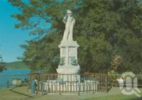 """<span class=""""caption-caption"""">Monument to the pioneers of the sugar industry made of Italian marble. The monument was donated by the Italian Community of Innisfail, 1959</span>, 1980. <br />Postcard by <span class=""""caption-publisher"""">Murray Views Pty Ltd</span>, collection of <span class=""""caption-contributor"""">Centre for the Government of Queensland</span>."""