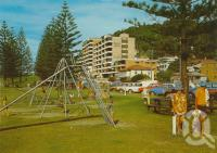 "<span class=""caption-caption"">Esplanade, Burleigh Heads</span>, 1975. <br />Postcard by <span class=""caption-publisher"">Murray Views Pty Ltd</span>, collection of <span class=""caption-contributor"">Centre for the Government of Queensland</span>."