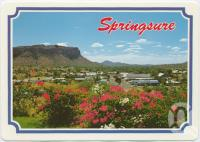 "<span class=""caption-caption"">Springsure, nestled into its mountain backdrop</span>, c1970-2000. <br />Postcard, collection of <span class=""caption-contributor"">Murray Views Collection</span>."